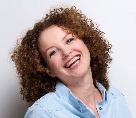 Older woman with curly hair laughing