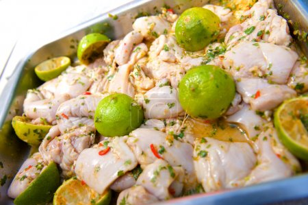 Photo for Close up raw chicken in lemon and chilli marinade - Royalty Free Image