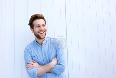 Photo for Portrait of an attractive young man laughing with arms crossed - Royalty Free Image