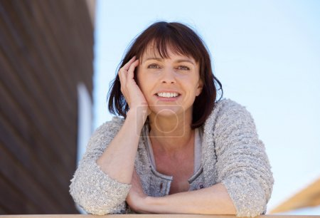 Fresh natural older woman smiling outdoor