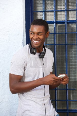 Happy guy with headphones and mobile phone