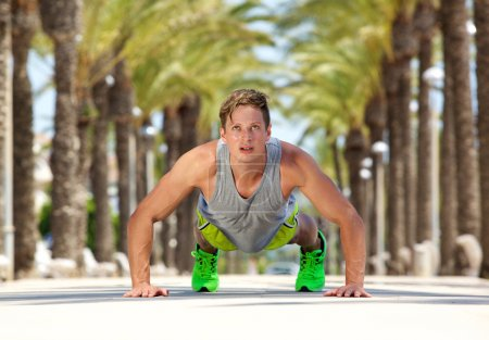 Young man cross fit exercise push ups