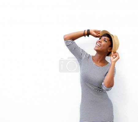 Cheerful black woman smiling with hat