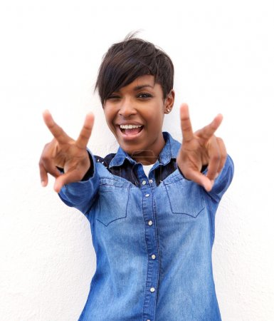 Cheerful african american woman with peace hand sign
