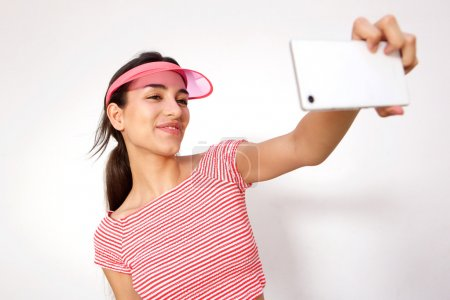 Smiling girl taking selfie with mobile phone