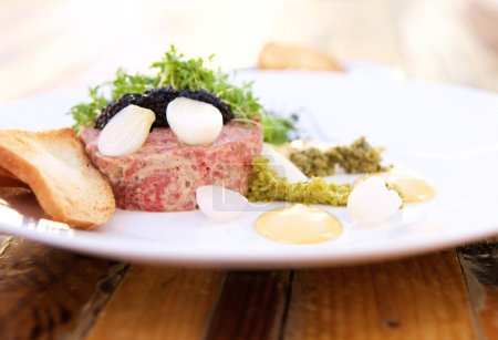 Photo for Close up caviar and steak tartare with toast - Royalty Free Image