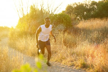 Fit young black man running exercise outdoors