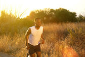 Handsome young african american man running exercise