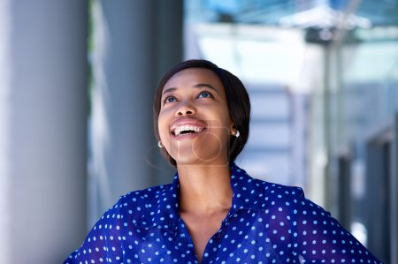 African business woman laughing and looking up