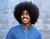 Cool young black guy smiling with afro