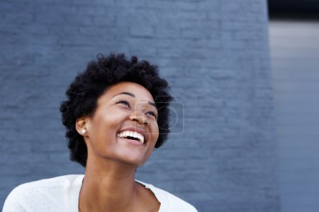 Photo for Portrait of smiling young african woman looking away at copy spac - Royalty Free Image