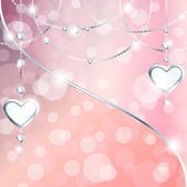 Sparkly peach pink background with silver heart-shaped pendants
