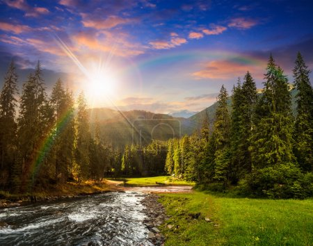 Photo for Collage landscape with pine trees in mountains and a river in front flowing to lake in sunset light with rainbow - Royalty Free Image