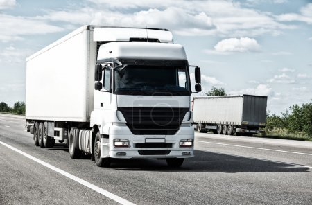 trucks drive on road, cargo transportation concept