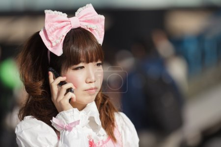 Japanese woman phoning