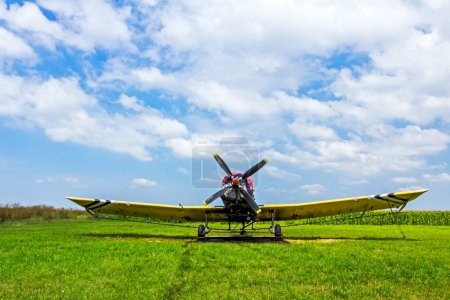Crop duster airplane on airfield