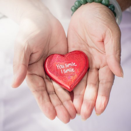 Red heart in senior's hands