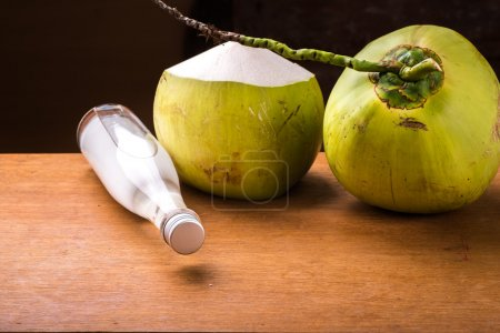Bottle of Cold coconut oil on table.