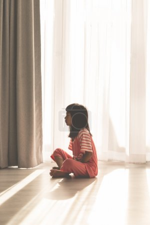 Young girl sitting on floor
