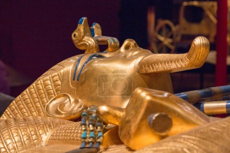 King Tut laying down