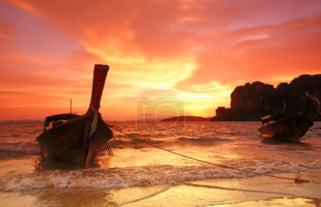 longtail boat sunset at Pranang beach Railay krabi Thailand