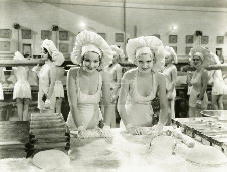 Women Rolling in dough...