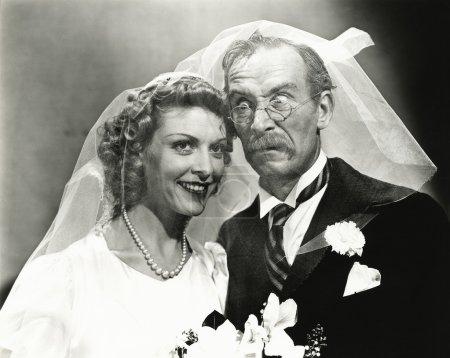 Photo pour Old Fashioned. Jour de mariage hijinks - image libre de droit