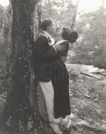 Man and woman embracing