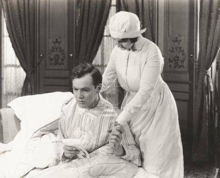 Nurse consoles her patient