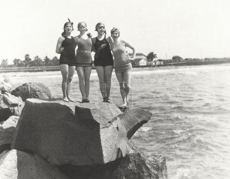 Women in bathing suits posing