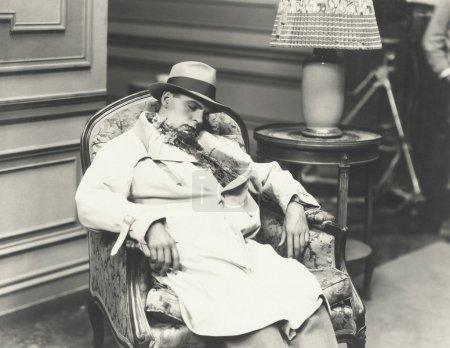 Man sleeping in chair