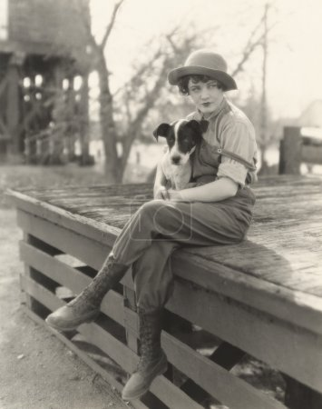 Woman sitting outdoors with her dog