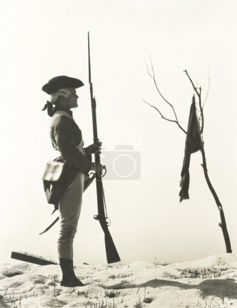 soldier looking at flag