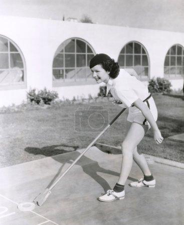 woman playing shuffleboard
