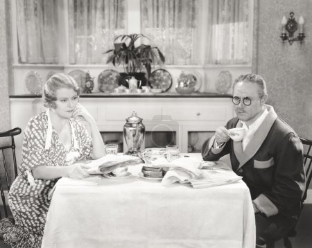 man and woman Contemplating over breakfast