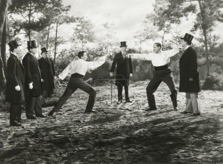 men sword fighting