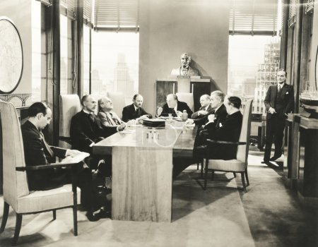 businessmen sitting at table