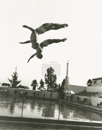 Synchronized divers in mid-air