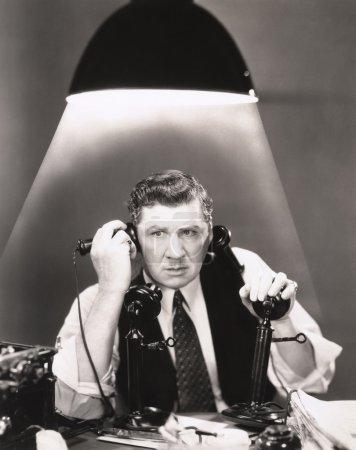 man using phones