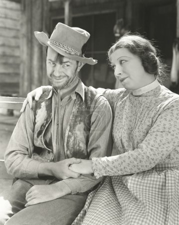 Affectionate cowboy with woman
