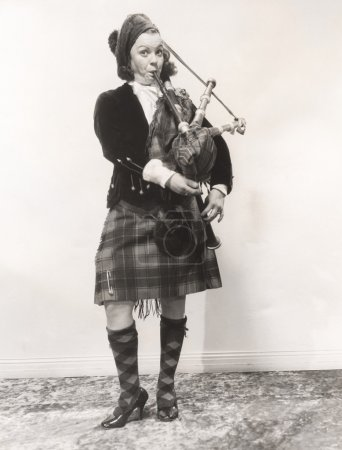young woman playing bagpipes