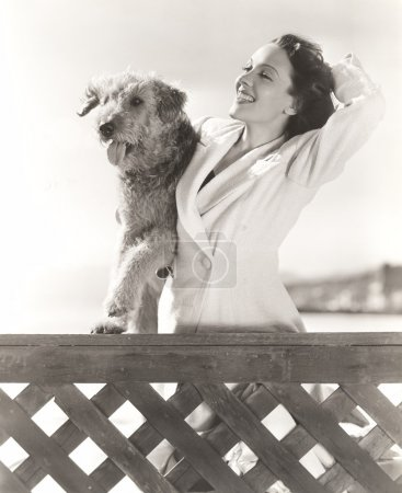 Woman posing with her Airedale