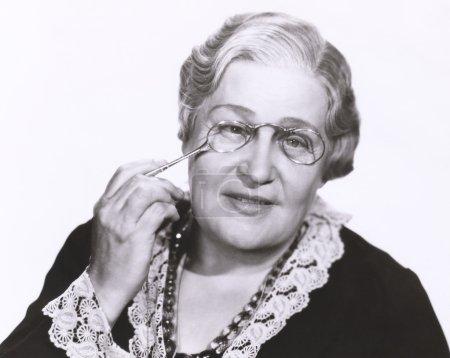 Woman holding lorgnette