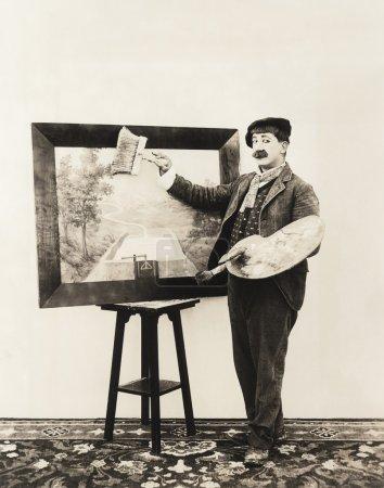 Painter holding brush