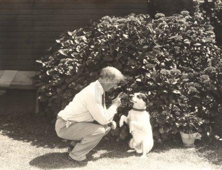man teaching dog