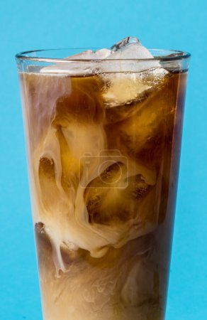 Photo for Cup of iced coffee on blue background - Royalty Free Image