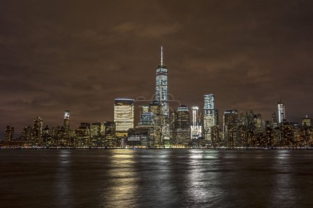 Photo for Skyline of New York City Manhattan viewed from New Jersey at night - Royalty Free Image