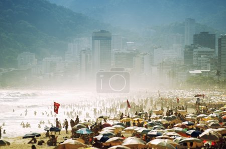 Photo for Busy crowded summer day on misty Ipanema Beach Rio de Janeiro Brazil - Royalty Free Image