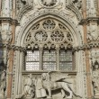 Close up of the Porta della Carta entrance to the Doge's Palace in Venice Italy features St Mark and winged Lion of Saint Mark, the patron saint symbol of the city