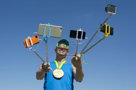 Gold Medal Athlete Taking Selfies with Selfie Sticks